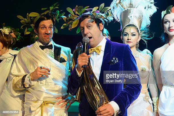 'ABSINTHE' cast member The Gazillionaire looks on as producer Ross Mollison speaks during the show's fourth anniversary party at Caesars Palace on...