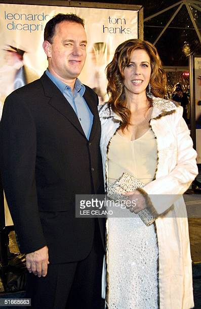 Cast member Tom Hanks arrives with wife Rita Wilson for the premiere of the film Catch Me If You Can 16 December 2002 in the Westwood area of Los...