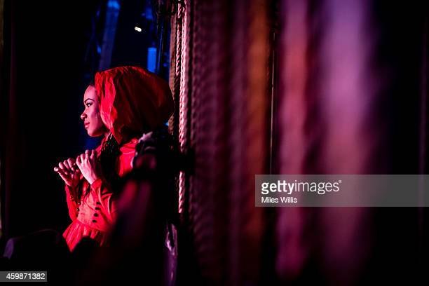 A cast member waits stage left during a performance of Mother Goose at Hackney Empire on December 2 2014 in London England