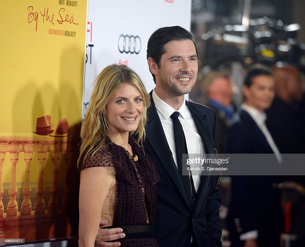 Cast members actress Melanie Laurent (L) and Melvil Poupaud pose during the opening night gala premiere of Universal Pictures' 'By the Sea'' during AFI FEST 2015 presented by Audi at TCL Chinese 6 Theaters November 5, 2015, in Hollywood, California.