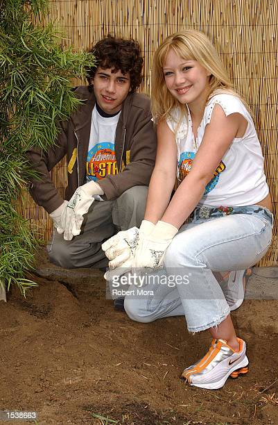 Cast Members Adam Lamberg and Hilary Duff of Dinsey's Lizzie McGuire volunteer to refurbish the grounds at the Boys and Girls Club of Burbank April...