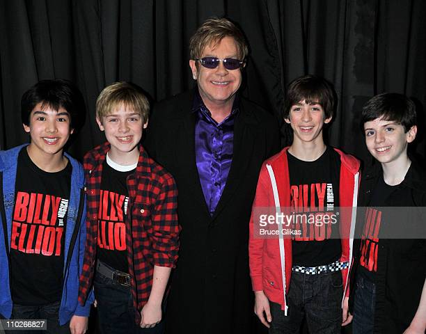 Cast members Alex Ko Joseph Harrington Jacob Clemente and Peter Mazurowski from 'Billy Elliot' on Broadway pose with Elton John backstage at his...