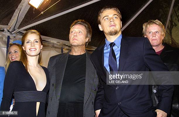 Cast members Amy Adams Christopher Walken Leonardo DiCaprio and Gary Busey pose for a photo opportunity after arriving for the premiere of the film...