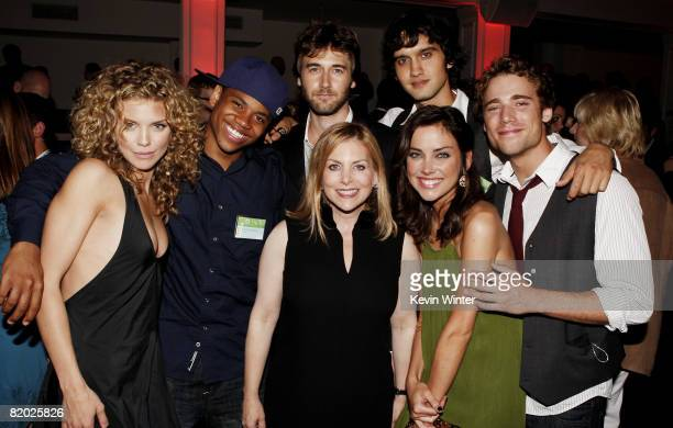 90210 cast members AnnaLynne McCord Tristan Wilds Ryan Eggold Michael Steger Jessica Stroup and Dustin Milligan pose with Dawn Ostroff CW...