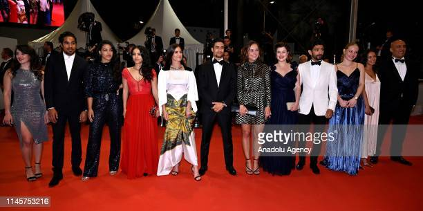 Cast members arrive for the screening of the film 'Mektoub My Love Intermezzo' during the 72nd annual Cannes Film Festival in Cannes France on May 23...