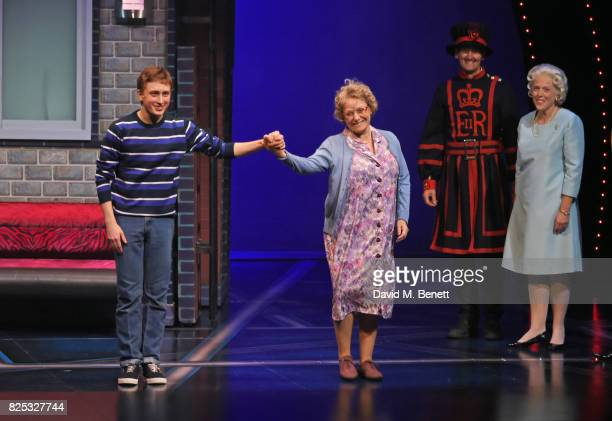 Cast members Ashley Cousins and Gilly Tompkins bow at the curtain call as Richard James and Louise Bailey look on during the press night performance...