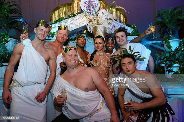 ABSINTHE cast members attend the show's fourth anniversary party at Caesars Palace on April 1 2015 in Las Vegas Nevada