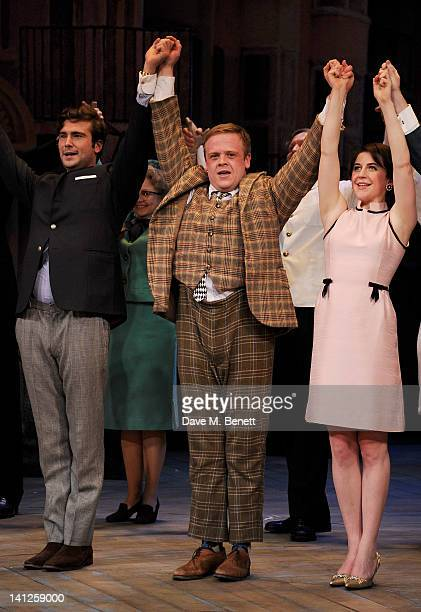 Cast members Ben Mansfield Owain Arthur and Gemma Whelan bow at the curtain call during the press night performance of 'One Man Two Guvnors' as it...