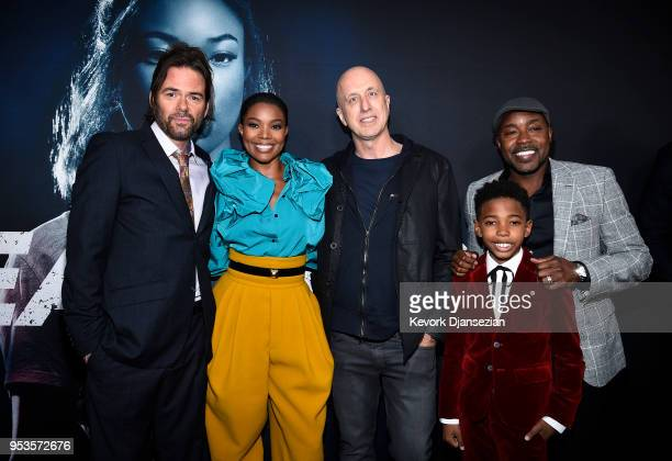 Cast members Billy Burke Gabrielle Union director James McTeigue cast member Seth Carr and producer Will Packer pose during Universal Pictures'...