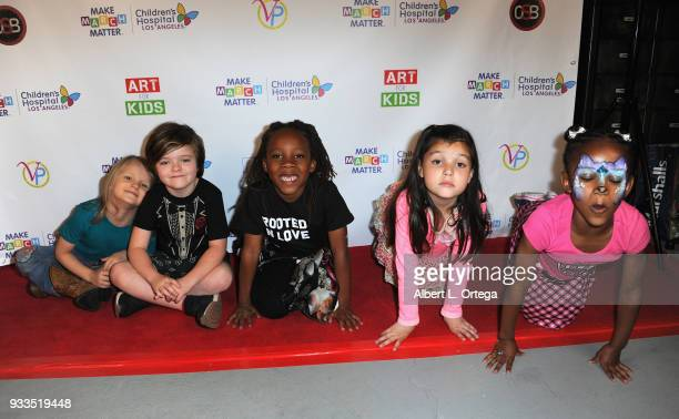 Cast members Bowie Bundlie Harlo Haas Zakai Karter Madelyn Friedman and Dharma attend Art For Kids And The Cast Of USA Networks' 'The Secret Lives Of...