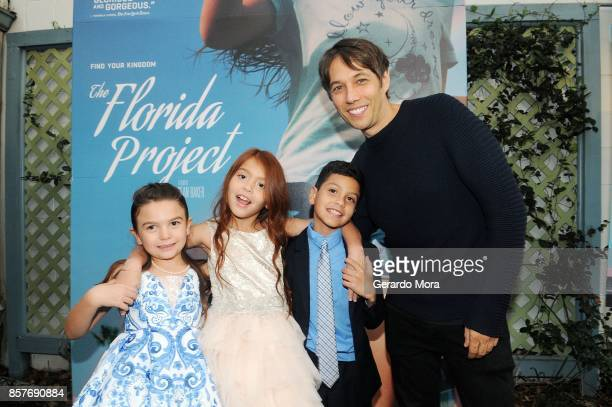 Cast members Brooklynn Prince Valeria Cotto Christopher Rivera and Director Sean Baker pose during THE FLORIDA PROJECT Cast Crew Orlando Premiere at...