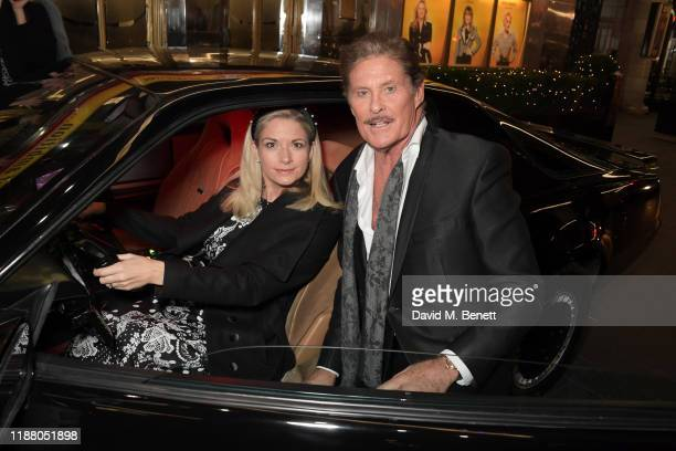 Cast members Caroline Sheen and David Hasselhoff pose with KITT from Knight Rider at the gala party to celebrate David Hasselhoff joining the cast of...