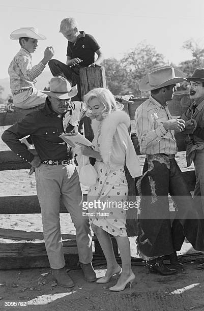 Cast members Clark Gable Marilyn Monroe and Montgomery Clift during the filming of 'The Misfits' on location in the Nevada Desert