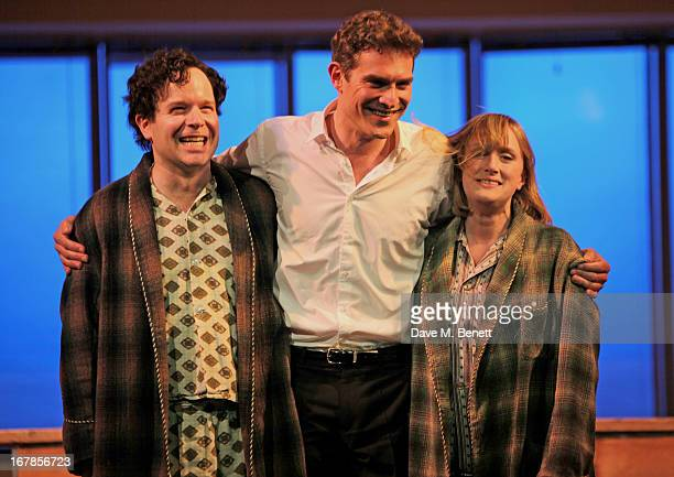 Cast members Damian Humbley Mark Umbers and Jenna Russell bow at the curtain call during the press night performance of the Menier Chocolate...