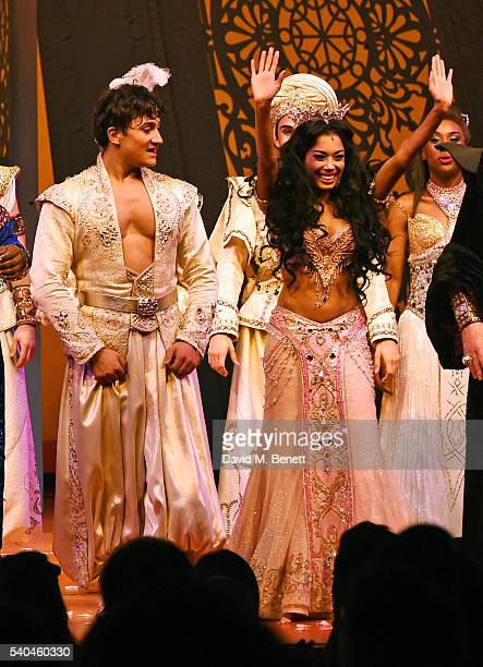 Cast members Dean JohnWilson and Jade Ewen bow at the curtain call during the press night performance of Disney's Aladdin at The Prince Edward...