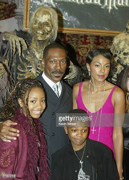 Cast members Eddie Murphy Marsha Thomason Aree Davis and Marc John Jeffries pose at the premiere of 'The Haunted Mansion' held on November 23 2003 at...