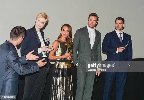Cast members Elizabeth Debicki Alicia Vikander Armie Hammer and Henry Cavill attend the premiere of Warner Bros Pictures' 'The Man From UNCLE' at...