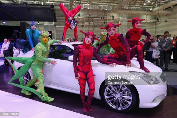 Cast members from Cirque du Soleil perform at the Infiniti stand during the Australian International Motor Show media preview at the Sydney...