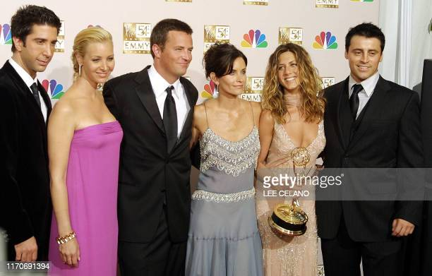 Cast members from Friends which won Outstanding Comedy series pose for photogarpher at the 54th Annual Emmy Awards at the Shrine Auditorium in Los...