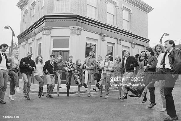 Cast members from the BBC television soap opera EastEnders pictured together on the Albert Square set at Elstree Studios in Elstree England in 1985...