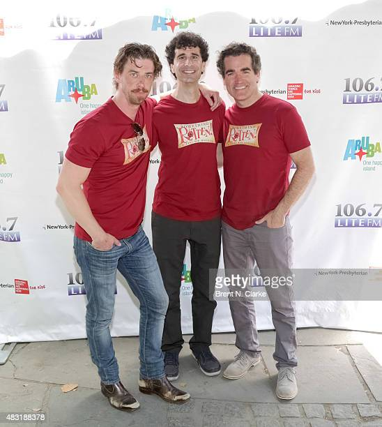 Cast members from the broadway musical 'Something Rotten' Christian Borle John Cariani and Brian d'Arcy James pose for photographs during 1067 LITE...