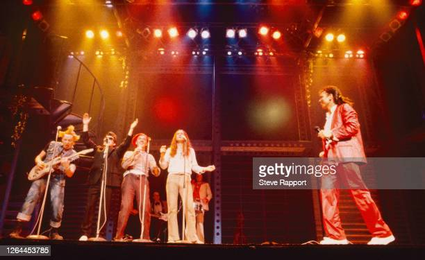 Cast members from the television show 'The Young Ones' appear with singer Cliff Richard Comic Relief Shaftesbury Theatre London 4/25/1986 Pictured...