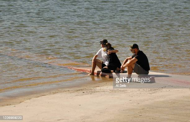 """Cast members from the TV Show """"Glee"""" and friends comfort each other as they gathered on the Lake Piru boat launch Monday morning just as Ventura..."""