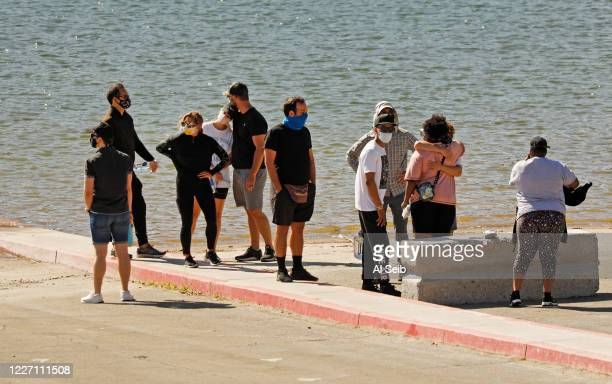 Cast members from the TV Show Glee and friends comfort each other as they gathered on the Lake Piru boat launch Monday morning just as Ventura County...
