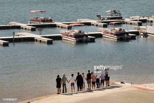 "Cast members from the TV Show ""Glee"" and friends held hands as they shouted ""Say her name - Naya"" as they gathered on the Lake Piru boat launch..."
