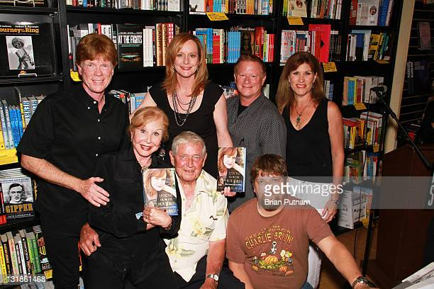 Cast members from 'The Waltons' Jon Walmsley Michael Learned Mary McDonough Ralph Waite Eric Scott David W Harper and Judy Norton attend the signing...