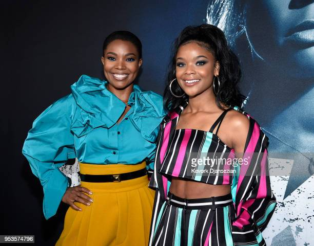 Cast members Gabrielle Union and Ajiona Alexus pose during Universal Pictures' special screening of the film 'Breaking In' at ArcLight Cinemas on May...