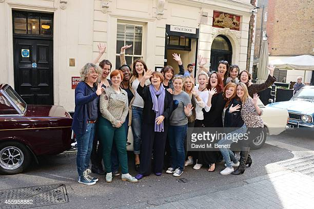 Cast members Gemma Arterton and Isla Blair pose with the ladies of the Made In Dagenham company as they arrive at The Adelphi Theatre on September 22...