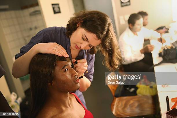 """Cast members, including actress Esther Zimmering and """"Ona,"""" of """"GRENZFAeLLE"""", a play that stars African refugees and German actresses, prepare for a..."""