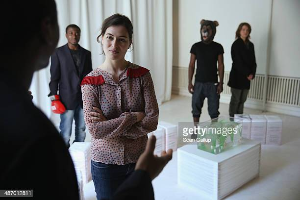 """Cast members, including actress Esther Zimmieering , of """"GRENZFAeLLE"""", a play that stars African refugees and German actresses, rehearse a scene at..."""