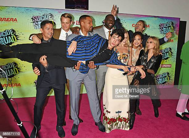 Cast members including Jay Hernandez Joel Kinnaman Will Smith Adewale AkinnuoyeAgbaje Ezra Miller Margot Robbie Karen Fukuhara Cara Delevingne and...
