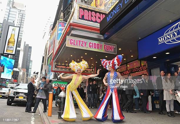 Cast members Jeff Metzler and Bryan West of Broadway's Priscilla Queen Of The Desert attend the unveiling of the 3D New York Taxi Tops at Palace...
