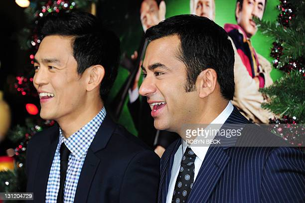 cast members john cho and kal penn arrive at the los angeles premiere of a very - A Very Harold Kumar 3d Christmas Cast