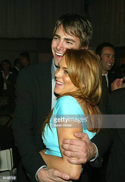 Cast members Jonathan Bennett and Lindsay Lohan hug at the afterparty for Paramount's Mean Girls at the Cinerama Dome Theater on April 19 2004 in Los...
