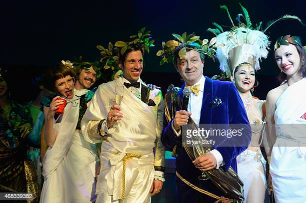 'ABSINTHE' cast members Joy Jenkins and The Gazillionaire look on as producer Ross Mollison speaks during the show's fourth anniversary party at...