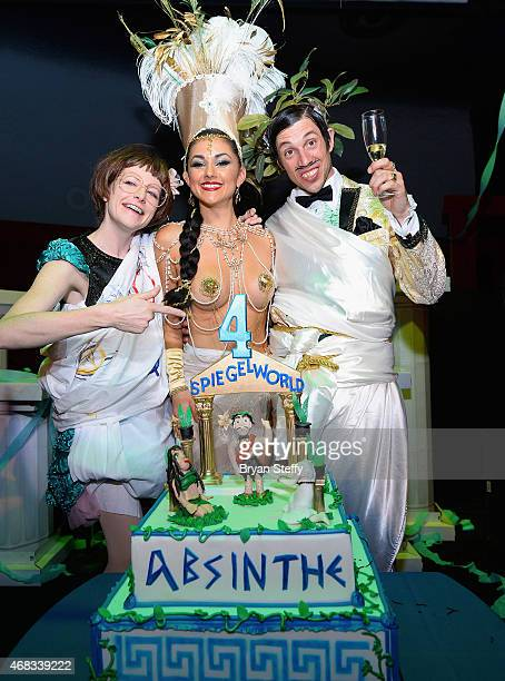 ABSINTHE cast members Joy Jenkins Melody Sweets and The Gazillionaire attend the show's fourth anniversary party at Caesars Palace on April 1 2015 in...