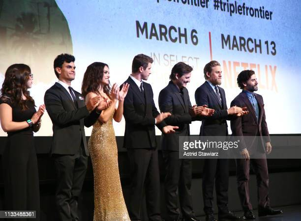 Cast members Maddy Wary Juan Castillo Adria Arjona Garrett Hedlund Pedro Pascal Charlie Hunnam and Oscar Isaac appear on stage during Netflix World...