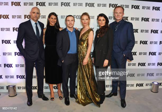Cast members Mark Strong Karima McAdams Joe Dempsie Anastasia Griffith Lyne Renee and Alistair Petrie attend the Global Premiere of 'Deep State' the...