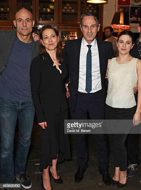 Cast members Mark Strong Nicola Walker director Ivo van Hove and Phoebe Fox attend the after party following the press night performance of A View...