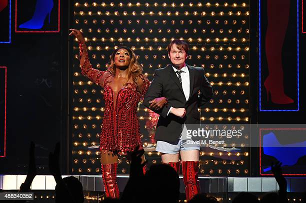 Cast members Matt Henry and Killian Donnelly bow at the curtain call during the Kinky Boots opening night at The Adelphi Theatre on September 15 2015...