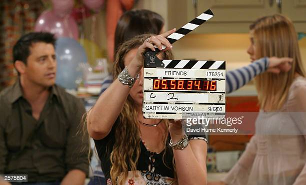 Cast members Matt LeBlanc Courteney Cox and Jennifer Aniston prepare to shoot a scene of their hit NBC series 'Friends' during one of their last...