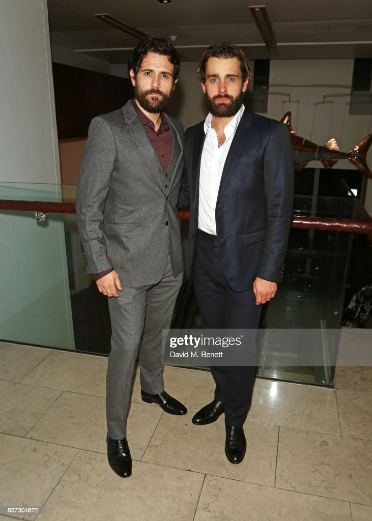 Cast members Matt Ryan (L) and Christian Cooke attend the press night after party of 'Knives In Hens' at The Hospital Club on August 22, 2017 in London, England.