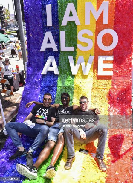 Cast members Miguel Angel Silvestre Toby Onwumere and Brian Smith pose for portrait on top of Sense8 float at LA Pride Music Festival and Parade 2018...