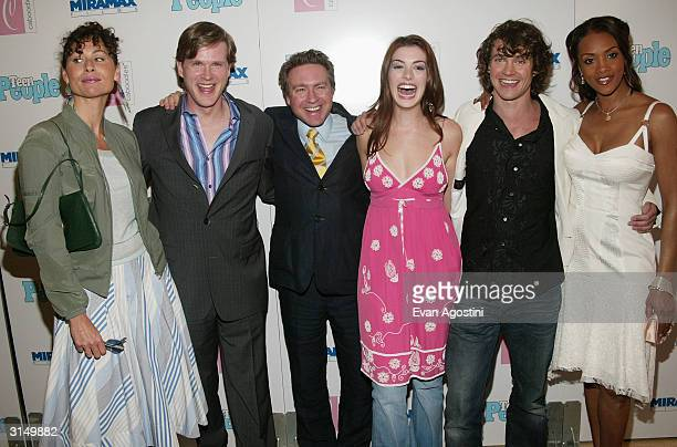 Cast members Minnie Driver Cary Elwes director Tommy O'Haver Anne Hathaway Hugh Dancy and Vivica A Fox attend the 'Ella Enchanted' film premiere at...