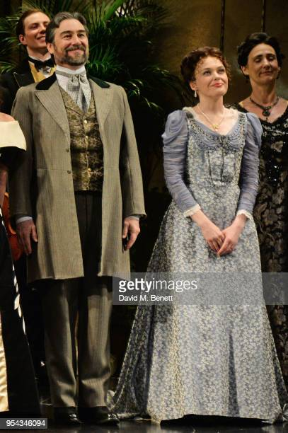 Cast members Nathaniel Parker and Sally Bretton bow at the curtain call during the press night performance of 'An Ideal Husband' at the Vaudeville...