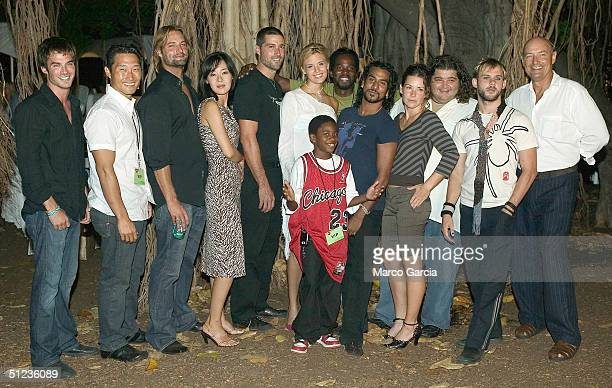 Cast members of ABC's new TV drama 'Lost' pose before a banyan tree at the premiere of the show on Queen's Surf Beach in August 28 2004 in Waikiki in...